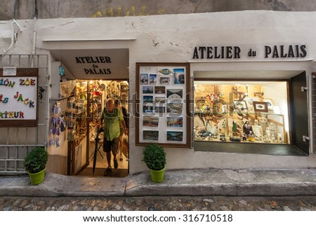 AVIGNON, FRANCE - AUGUST 12, 2015: Tourists exiting small atelier.
