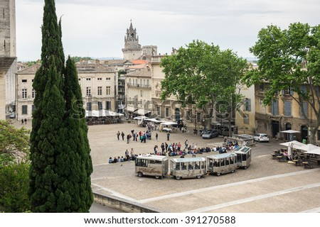 AVIGNON, FRANCE - MAY 04, 2015: Tourists on the square of Popes Palace Avignon. Popes Palace is the main historical site in Provence and one of the most important medieval gothic buildings in Europe