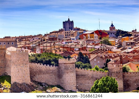 Avila Ancient Medieval City Walls Castle Swallows Castile Spain.  Avila is described as the most 16th century town in Spain.  Walls created in 1088 after Christians conquer the city from the Moors   - stock photo