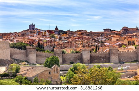 Avila Ancient Medieval City Walls Castle Swallows Castile Spain.  Avila is described as the most 16th century town in Spain.  Walls created in 1088 after Christians conquer the Moors   - stock photo