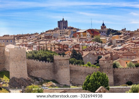 Avila Ancient Medieval City Walls Castle Swallows Castile Spain.  Most 16th century town in Spain.  Walls created in 1088 after Christians conquer and take the city from the Moors - stock photo