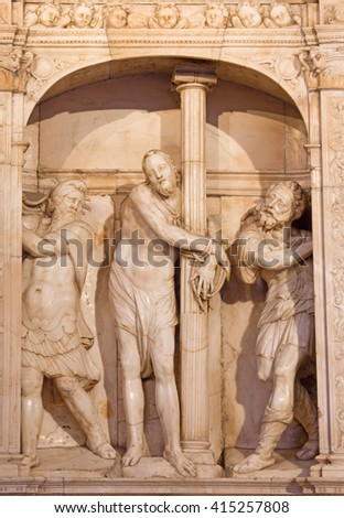 AVILA, SPAIN, APRIL - 18, 2016: The marble sculpture of Flagellation of Christ in sacristy of Catedral de Cristo Salvador on the altar by Isidro de Villoldo, Juan Frias and Pedro de Salamanca (1555).