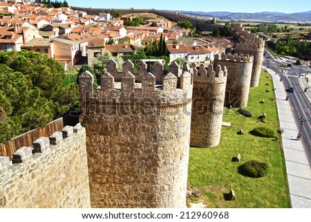 AVILA, SPAIN - JUNE 08, 2014: Old Fortress Walls. The centre of the city is completely encircled by two kilometre long 11th century walls, punctuated by 88 towers and 9 gateways                  - stock photo