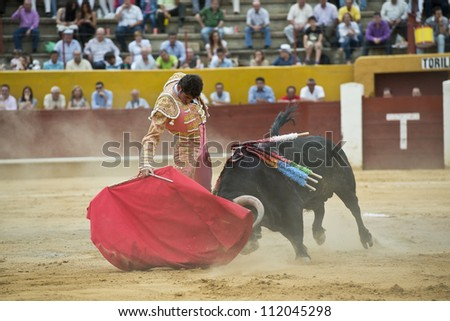 AVILA, SPAIN - JUNE 2: Serafi­n Marin fights in the welfare bullfight of Avila, a city near to Madrid in the middle of Spain in June 2, 2012. - stock photo