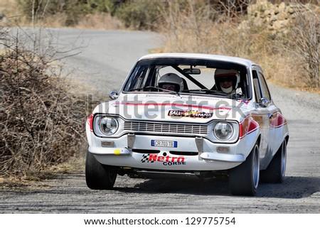 AVILA, SPAIN - MAR 10 : Italian driver Maurizio Elia and his Flavio Zanella codriver in a Ford Escort RS MkI race in the IV Historic Rally of Spain, on Mar 10, 2012 in Avila, Spain - stock photo