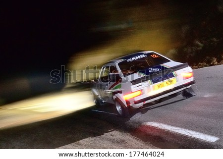 AVILA, SPAIN - MAR 1: Spanish driver Jose Marban and his codriver I�±aki Paez in a Ford Escort MkII RS races in the V Historic Rally of Spain , on Mar 1, 2013 in Avila, Spain.