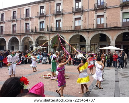 Avila, Spain October 12, 2014: Celebrations for the Bolivian election with typical dances of the South American country in Avila, Spain