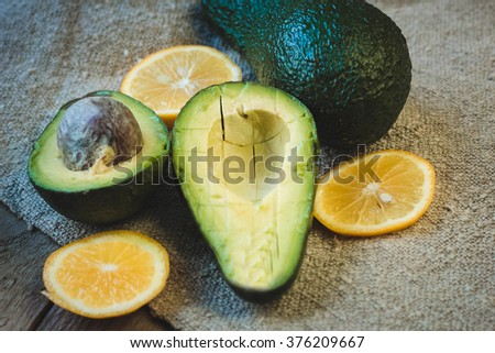 avocado and lemon on the dark wooden table