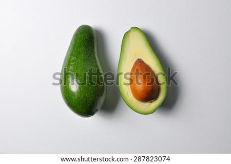 Avocado background white - stock photo