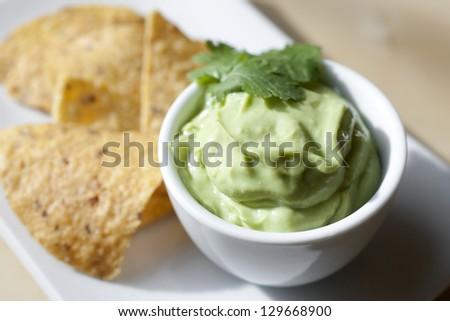 Avocado Cream Guacamole with Tortilla Chips - stock photo