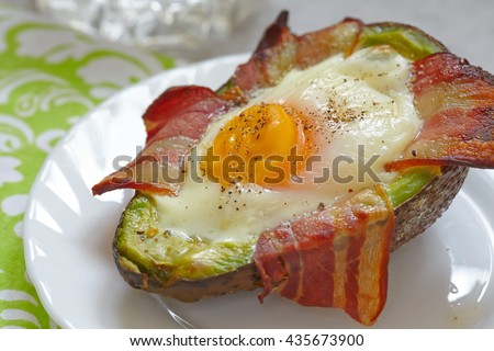 Avocado Egg Boats with bacon. Low carb high fat breakfast - stock photo