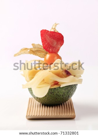 Avocado fruit and Swiss cheese - stock photo