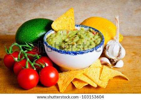 Avocado guacamole dip and ingredients - stock photo