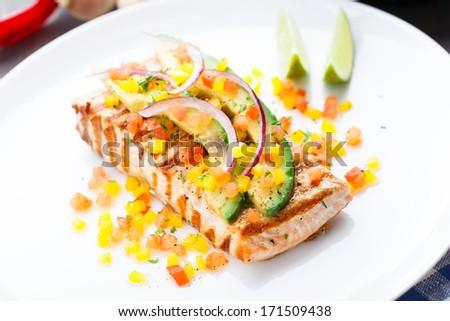 Avocado lime salmon - stock photo