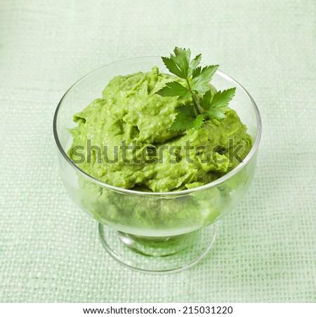 Avocado mousse on green napkin  - stock photo