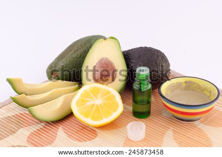 avocado oil and lemon on a light background