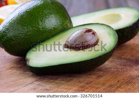 avocado on a dark wood background.