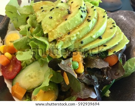 Avocado salad with egg tomato sesame and japanese style dressing