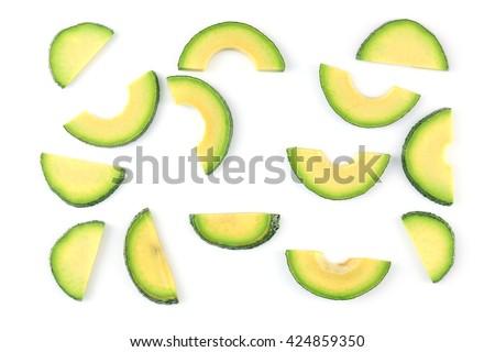 Avocado slices isolated on white - stock photo