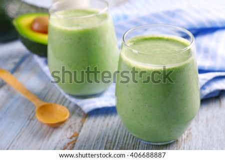 Avocado smoothie on wooden table closeup