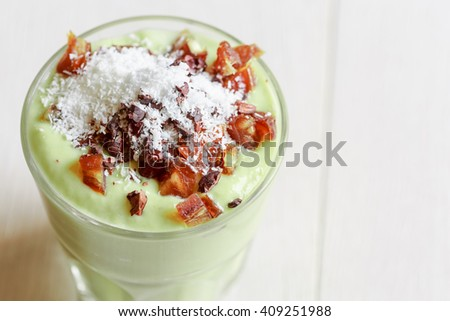 Avocado smoothie with Cacao nibs, coconut and dates - stock photo