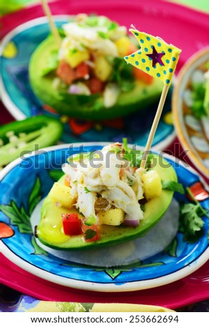 avocado stuffed with crabmeat, mango, red onions