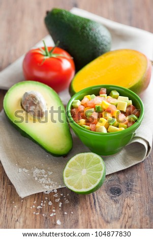 Avocado tomato mango salad with lime dressing, selective focus - stock photo