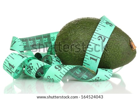 avocado with measuring tape isolated on white