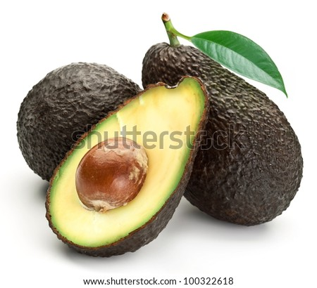 Avocados with leaves on a white background - stock photo