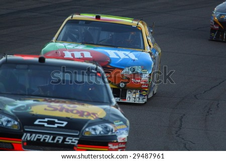 AVONDALE, AZ - APRIL 18: Kyle Busch (18) working in traffic during the opening laps of the NASCAR Sprint Cup Series race at Phoenix International Raceway April 18, 2009 in Avondale, AZ.