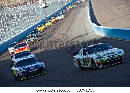 AVONDALE, AZ - APRIL 10: Tony Stewart (#14) and Jimmie Johnson (#48) lead the field during a yellow caution flag at the Subway Fresh Fit 600 NASCAR Sprint Cup race on April 10, 2010 in Avondale, AZ.