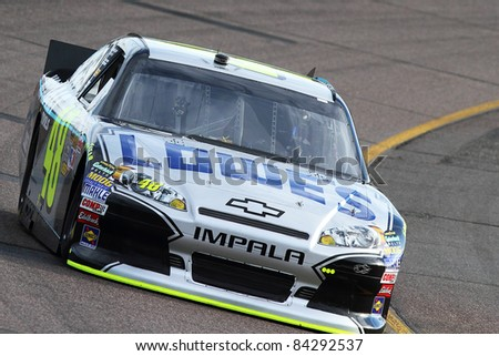 AVONDALE, AZ - FEB 25: Jimmie Johnson (48) at speed in a practice session for the SUBWAY Fresh Fit 500 race on Feb. 25, 2011 at the Phoenix International Raceway in Avondale, AZ. - stock photo