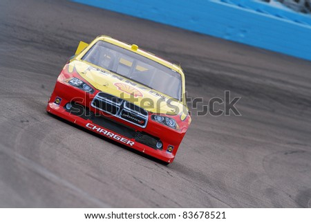 AVONDALE, AZ - FEB 25: Kurt Busch (22) at speed in a practice session for the SUBWAY Fresh Fit 500 race on Feb. 25, 2011 at the Phoenix International Raceway in Avondale, AZ. - stock photo
