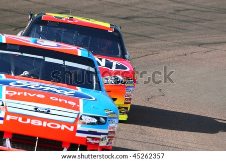 AVONDALE, AZ - NOV. 14: AJ Allmendinger leads Jeff Gordon during a practice session for the NASCAR Sprint Cup race, at Phoenix International Raceway on Nov. 14, 2009 in Avondale, AZ. - stock photo