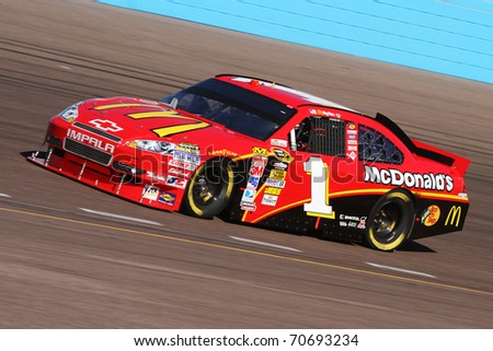 AVONDALE, AZ - NOV 13: Jamie McMurray (1) takes laps during a practice session for the Kobalt Tools 500 race on Nov 13, 2010 at the Phoenix International Raceway in Avondale, AZ. - stock photo