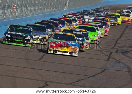 AVONDALE, AZ - NOV 14:  Kyle Busch (18) takes to the track during the Kobalt Tools 500 race on Nov 14, 2010 at the Phoenix International Raceway in Avondale, AZ.