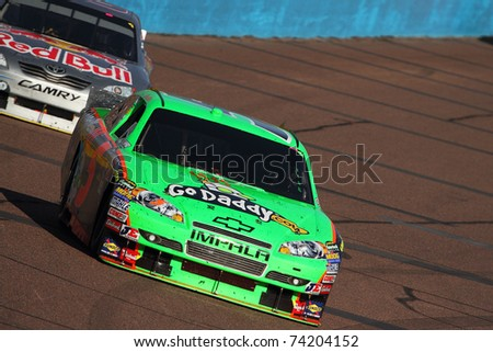 AVONDALE, AZ - NOV 14: Mark Martin (5) at speed in the Kobalt Tools 500 race on Nov 14, 2010 at the Phoenix International Raceway in Avondale, AZ. - stock photo