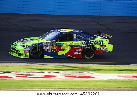 AVONDALE, AZ - NOV. 15:Mark Martin (5) in the opening laps of the NASCAR Sprint Cup Series, Checker O'Reilly Auto Parts 500 at Phoenix International Raceway on Nov. 15, 2009 in Avondale, AZ. - stock photo