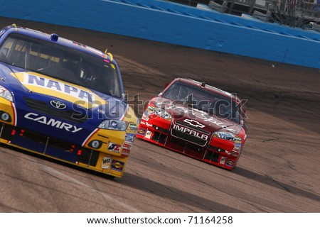 AVONDALE, AZ - NOV 14: Martin Truex Jr. (56) leads Tony Stewart (14) out of turn two during the Kobalt Tools 500 race on Nov 14, 2010 at the Phoenix International Raceway in Avondale, AZ.
