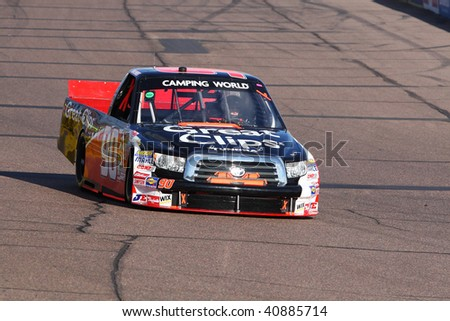 AVONDALE, AZ - NOVEMBER 13: Brad Sweet (90) qualifying his Toyota for the NASCAR Camping World Truck Series Lucas Oil 150 at Phoenix International Raceway on November 13, 2009 in Avondale, AZ.