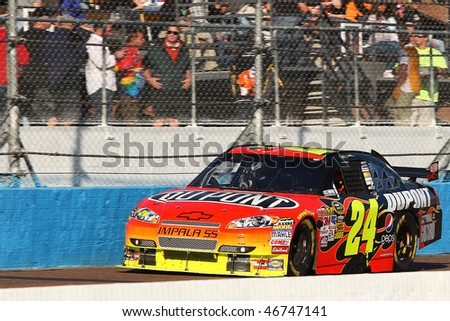 AVONDALE, AZ - NOVEMBER 15:Jeff Gordon (24) competes in the NASCAR Sprint Cup Series, Checker O'Reilly Auto Parts 500 at Phoenix International Raceway on November 15, 2009 in Avondale, AZ. - stock photo