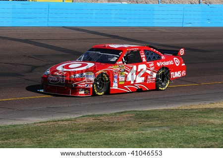 AVONDALE, AZ - NOVEMBER 15: Juan Pablo Montoya (42) competes in the NASCAR Sprint Cup Series, Checker O'Reilly Auto Parts 500 at Phoenix International Raceway on November 15, 2009 in Avondale, AZ. - stock photo