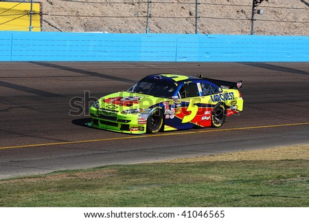AVONDALE, AZ - NOVEMBER 15: Mark Martin (5) competes in the NASCAR Sprint Cup Series, Checker O'Reilly Auto Parts 500 at Phoenix International Raceway on November 15, 2009 in Avondale, AZ. - stock photo