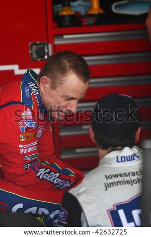 AVONDALE, AZ - NOVEMBER 13: Mark Martin (left) and Jimmie Johnson talk before a practice session for the NASCAR Sprint Cup Series, at Phoenix International Raceway on Nov. 13, 2009 in Avondale, AZ. - stock photo