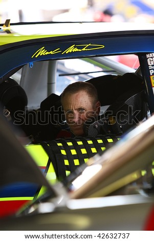 AVONDALE, AZ - NOVEMBER 13: Mark Martin waits in his car before a practice session for the NASCAR Sprint Cup Series, at Phoenix International Raceway on November 13, 2009 in Avondale, AZ. - stock photo