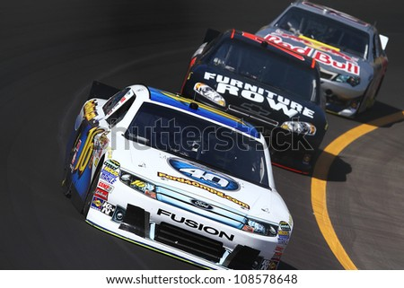 AVONDALE, AZ - OCT 5: Greg Biffle (16) leads a line of cars during a NASCAR Sprint Cup track testing session on Oct. 5, 2011 at Phoenix International Raceway in Avondale, AZ. - stock photo