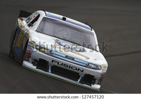 AVONDALE, AZ - OCT 4: Greg Biffle (16) takes laps during a NASCAR Sprint Cup track testing session on Oct. 4, 2011 at Phoenix International Raceway in Avondale, AZ. - stock photo