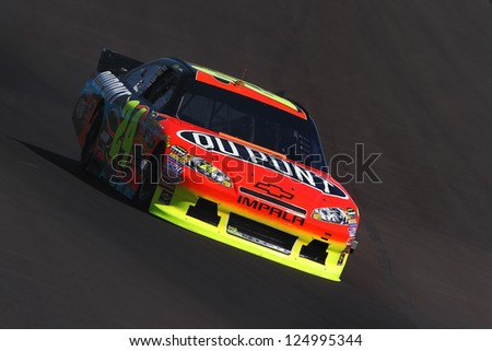 AVONDALE, AZ - OCT 5: Jeff Gordon (24) takes hot laps during a NASCAR Sprint Cup track testing session on Oct. 5, 2011 at Phoenix International Raceway in Avondale, AZ.