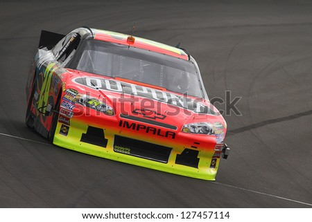 AVONDALE, AZ - OCT 4: Jeff Gordon (24) takes laps during a NASCAR Sprint Cup track testing session on Oct. 4, 2011 at Phoenix International Raceway in Avondale, AZ. - stock photo