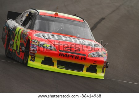 AVONDALE, AZ - OCT 4: Jeff Gordon (24) takes laps during a track testing session on Oct. 4, 2011 at Phoenix International Raceway in Avondale, AZ. - stock photo